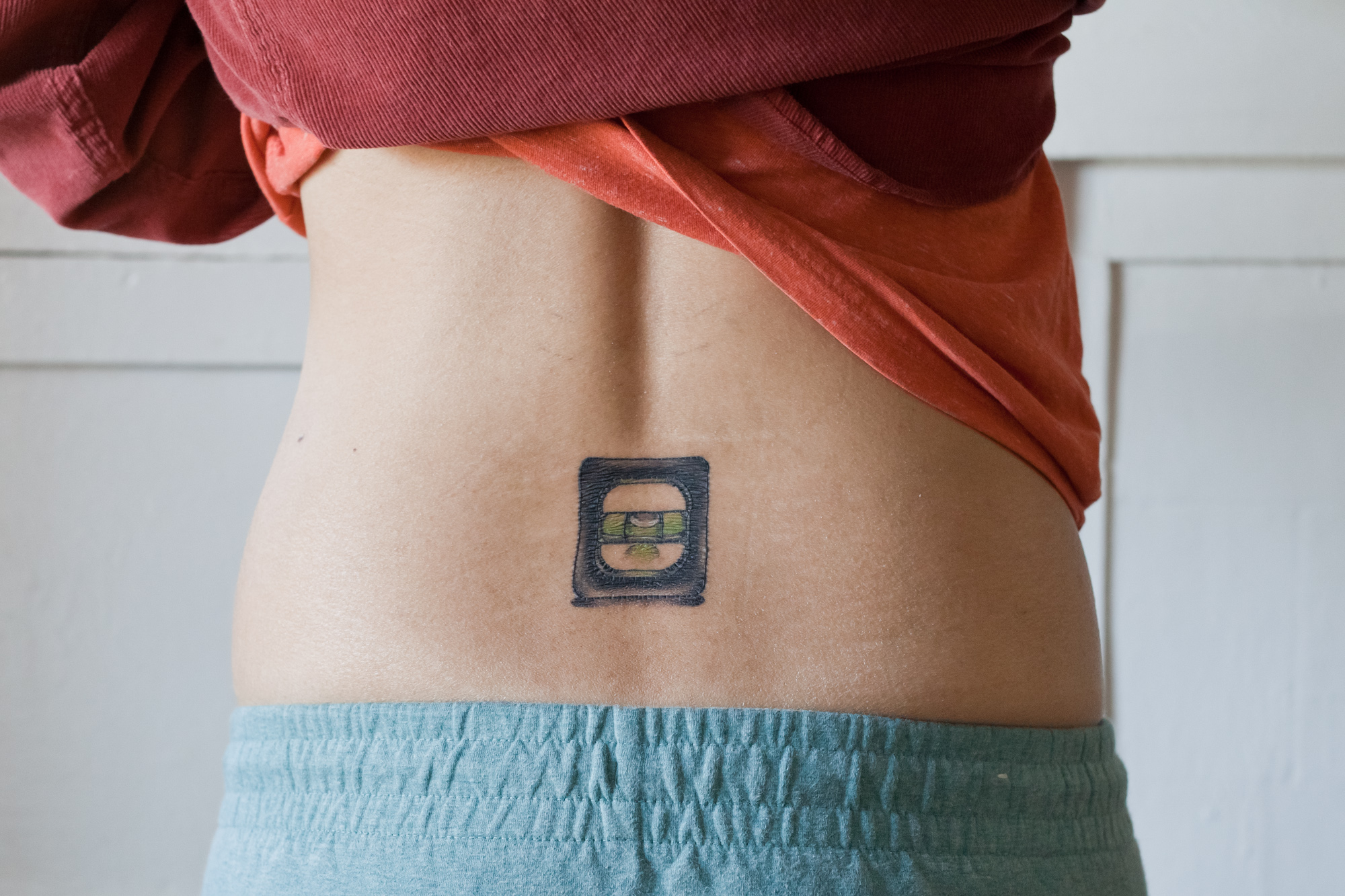 Image of my first bad tattoo, a bubble level tramp stamp